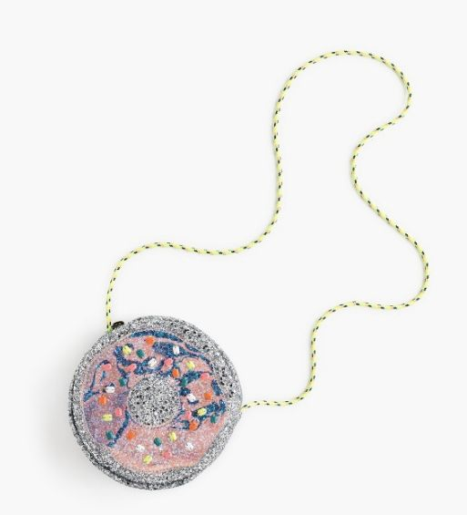 "Buy the <a href=""https://www.jcrew.com/p/girls_category/bags/glitterbags/girls-glitter-donut-bag/G6736?srcCode=GGBS00006_crew"