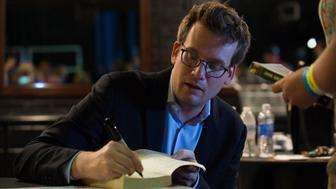 DALLAS, TX - JULY 16:  John Green signs autographs for fans on the 'Paper Towns' Get Lost Get Found tour at The Bomb Factory on July 16, 2015 in Dallas, Texas.  (Photo by Cooper Neill/Getty Images for Allied-THA)