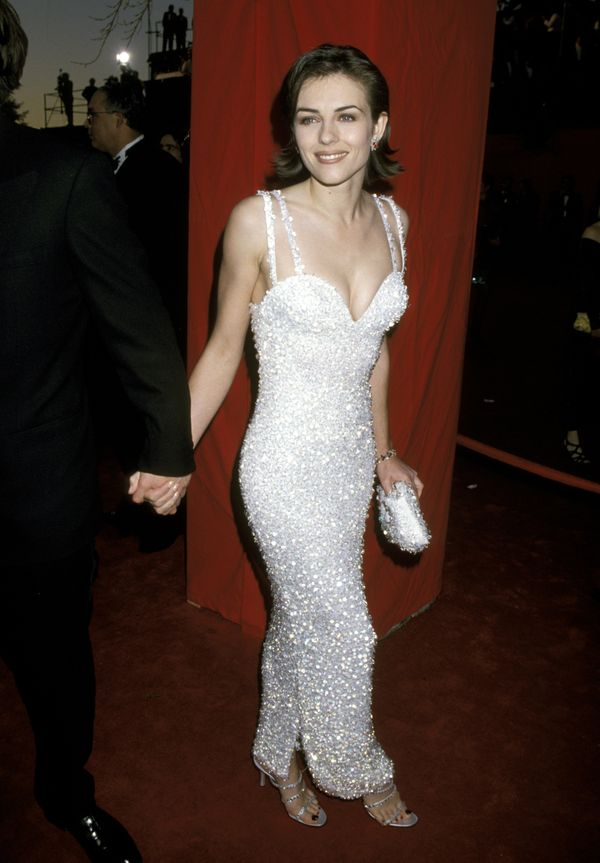 This Versace gown has landed Hurley on best-dressed Oscars lists for years. Gianni Versace, who was murdered in 1997, and his