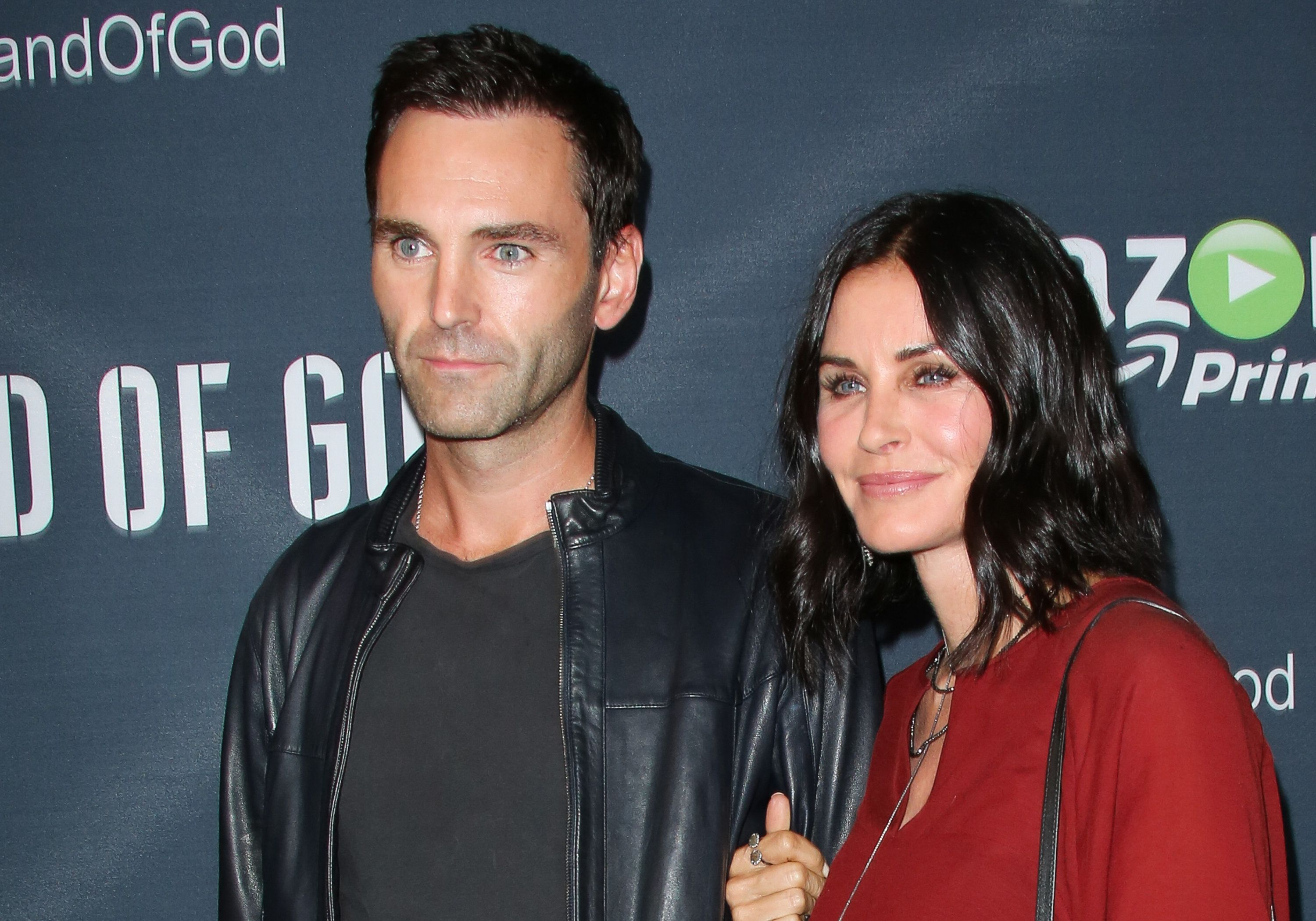 LOS ANGELES, CA - AUGUST 19:  Screen Writer Johnny McDaid (L) and Actress Courteney Cox (R) attend the premiere of Amazon's series 'Hand Of God' at Ace Theater Downtown LA on August 19, 2015 in Los Angeles, California.  (Photo by Paul Archuleta/FilmMagic)