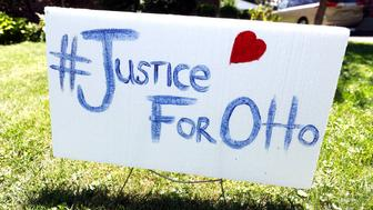 WYOMING, OH-JUNE 21:  A sign on the front lawn of Lauren Wadds Wyoming, Ohio home proclaims, '#Justice For Otto' as the the town of Wyoming prepares for the funeral of Otto Warmbier June 21, 2017 in Wyoming, Ohio. The 22-year-old college student was released from a North Korean prison last Tuesday in a coma after spending 17 months in captivity for allegedly stealing a propaganda poster.  (Photo by Bill Pugliano/Getty Images)