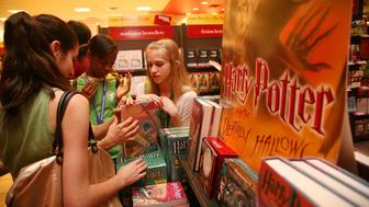 NEW YORK - JULY 20:  Excited Harry Potter fans purchase their copy of the book 'Harry Potter And The Deathly Hallows' at Borders inside the Time Warner Center on July 20, 2007 in New York City.  (Photo by Astrid Stawiarz/Getty Images)
