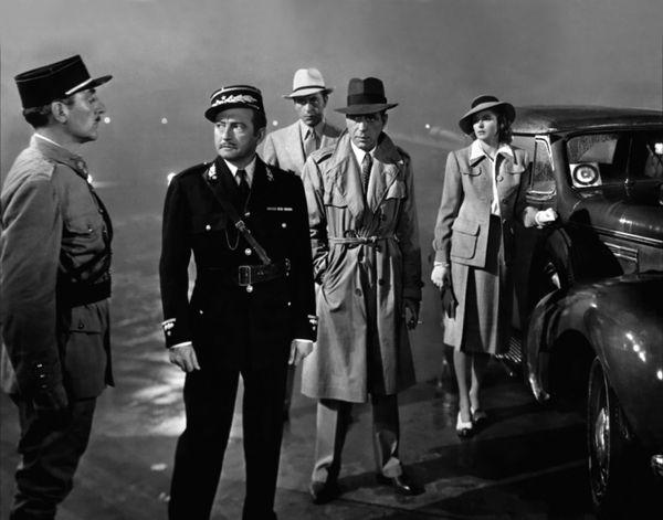 "Seen here withHumphrey Bogart, Paul Henreid, and Claude Rains, Ingrid Bergman's famous ""Casablanca"" style was created t"
