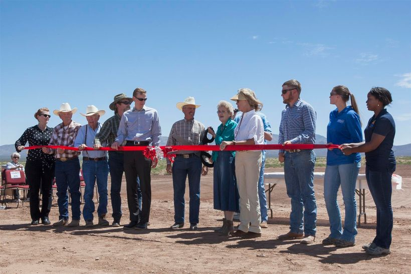 Ann English, chairwoman of the Cochise County Board of Supervisors, cuts the ribbon opening the Horseshoe Draw project for th