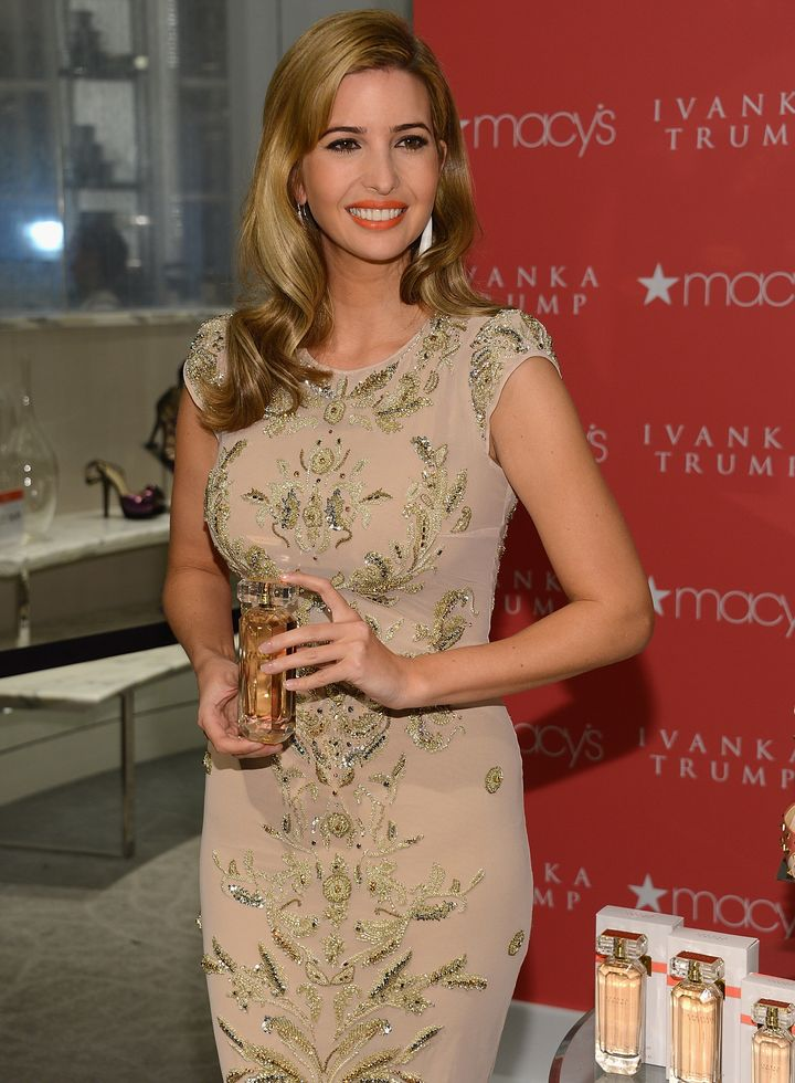 Ivanka Trump poses with her namesake fragrance at a 2013 press event.
