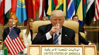 U.S. President Donald Trump drinks water before delivering a speech during Arab-Islamic-American Summit in Riyadh, Saudi Arabia May 21, 2017. REUTERS/Jonathan Ernst