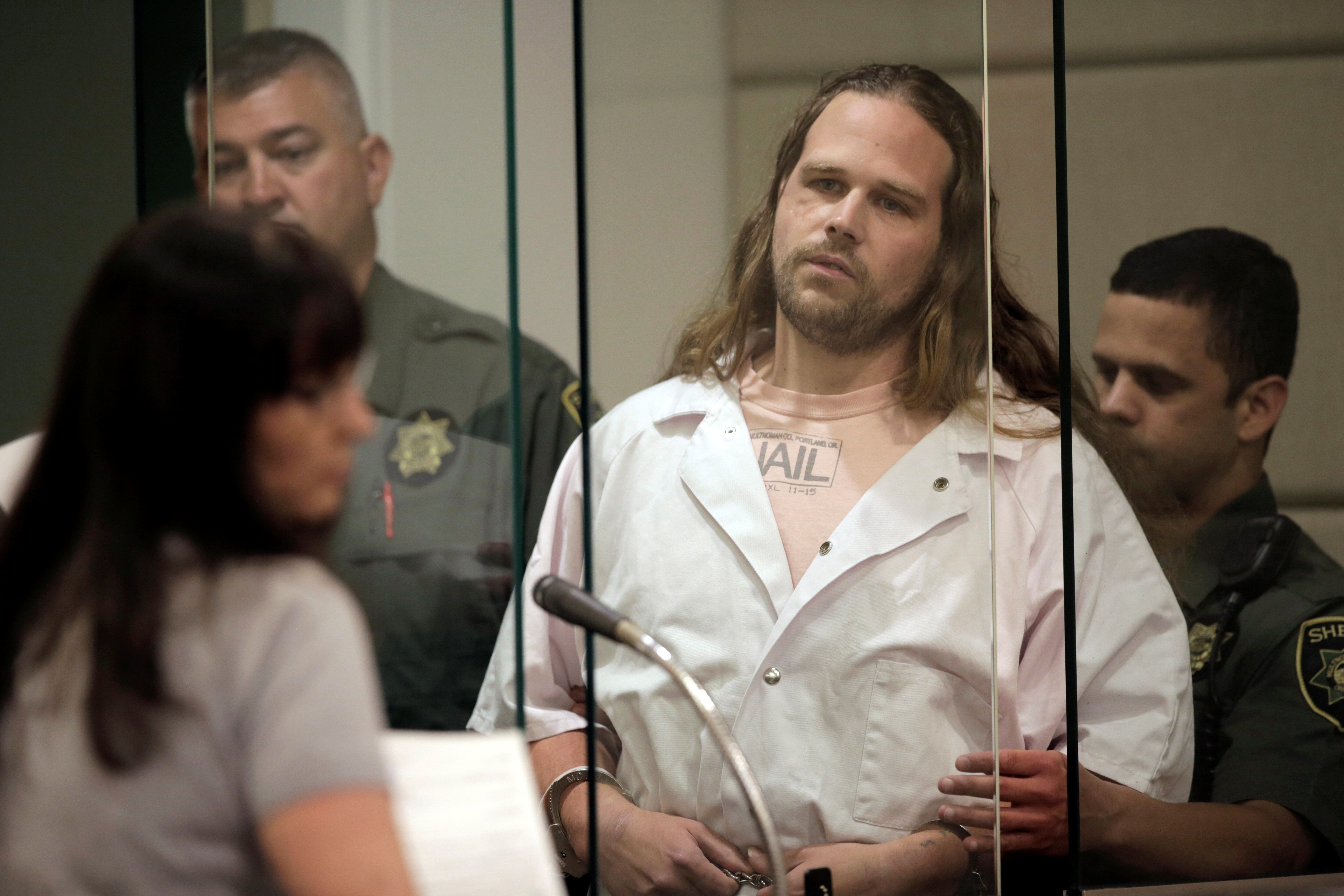 Jeremy Christian, arrested in the fatal stabbing of two men and wounding of another aboard a MAX train, is arraigned on a 15-count indictment in Multnomah County Circuit Court in Portland, Oregon, U.S., June 7, 2017.          Stephanie Yao Long/Pool