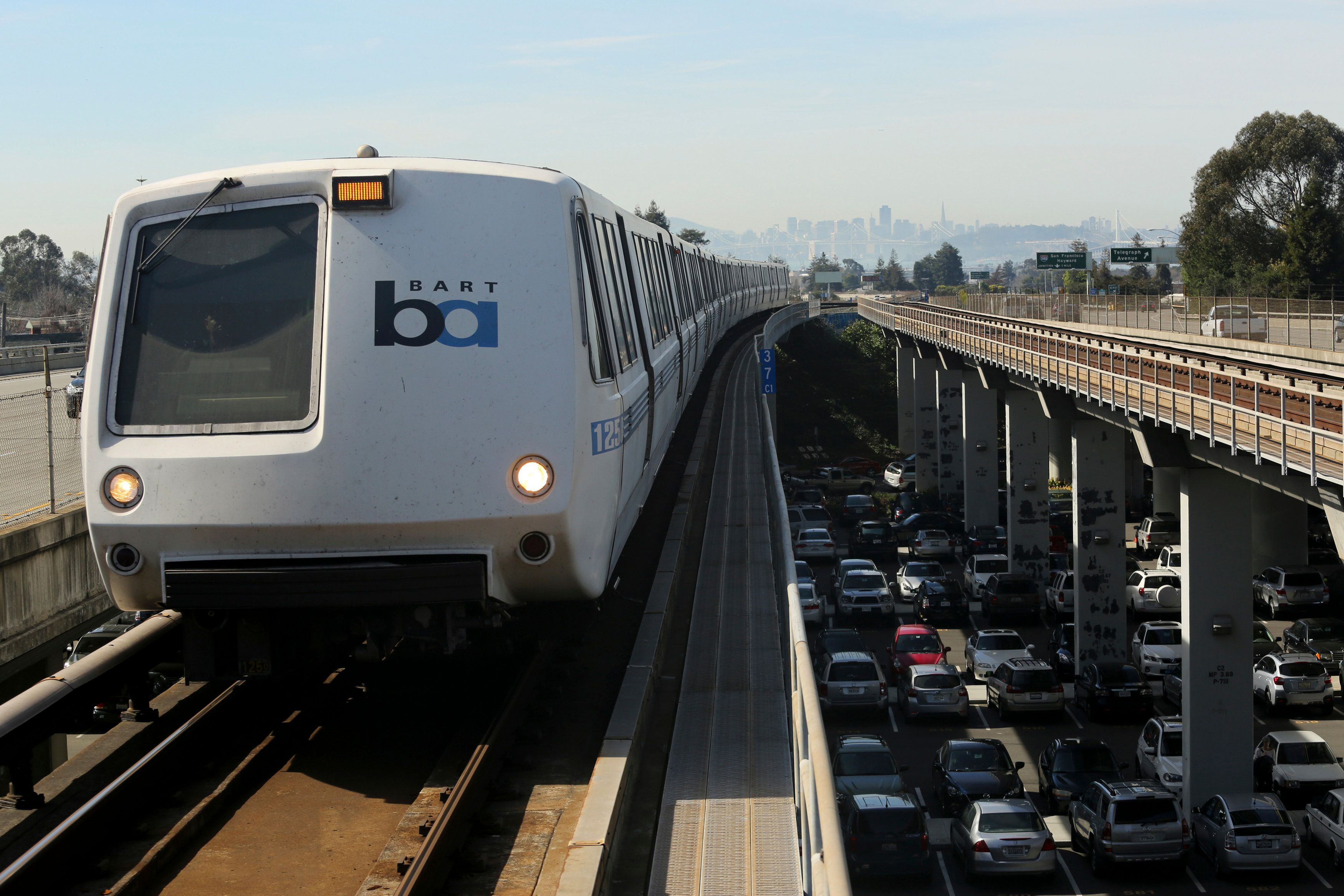 A Bay Area Rapid Transit (BART) train enters the platform area at the Rockridge station in Oakland, California.
