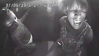 A still image from police video shows Diamond Reynolds crying next to her daughter while handcuffed in the back seat of a police patrol vehicle, after her boyfriend Philando Castile was fatally shot by St. Anthony Police Department officer Jeronimo Yanez during a traffic stop in the Falcon Heights suburb of St Paul, Minnesota, U.S. July 6, 2016. Minnesota Bureau of Criminal Apprehension/Handout via REUTERS     ATTENTION EDITORS -- THIS IMAGE HAS BEEN SUPPLIED BY A THIRD PARTY. TPX IMAGES OF THE DAY