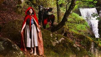 Amanda Knox dressed as Little Red Riding Hood watches out for beau Christopher Robinson dressed as the Big Bad Wolf