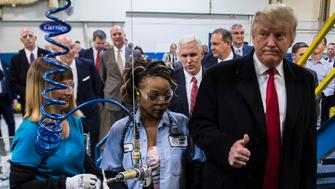 INDIANAPOLIS, IN - DECEMBER 1: President-elect Donald Trump and Vice President-elect Mike Pence meet workers as they take a tour of Carrier Corporation in Indianapolis, IN on Thursday, Dec. 01, 2016. (Photo by Jabin Botsford/The Washington Post via Getty Images)