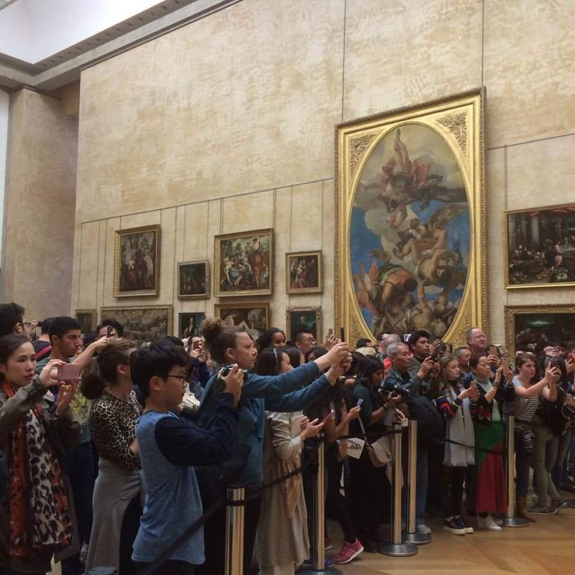 Photographing the Mona Lisa at the Louvre, Paris