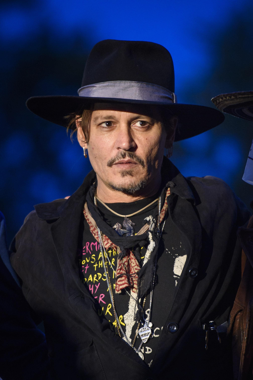 Johnny Depp Jokes About Assassinating Donald Trump During Glastonbury