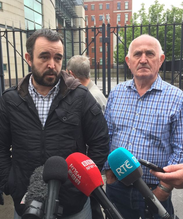 Ciaran, the son of murder victim Eamon Fox (L) and Joe, the father of victim Gary Convie, outside the...