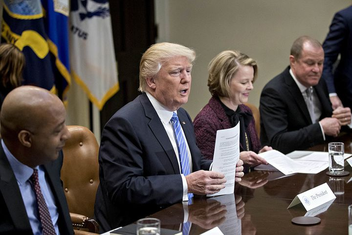 President Donald Trump at a listening session with CEOs from the retail industry in February. Seated from left to right are M