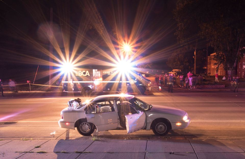 The car of Philando Castile is seen surrounded by police vehicles in an evidence photo taken after he was fatally shot by St.