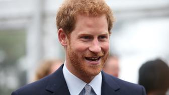 Britain's Prince Harry smiles during a function at Admiralty House in Sydney on June 7, 2017.  Prince Harry is in Sydney to launch the 2018 Invictus Games. / AFP PHOTO / POOL / DAVID MOIR        (Photo credit should read DAVID MOIR/AFP/Getty Images)