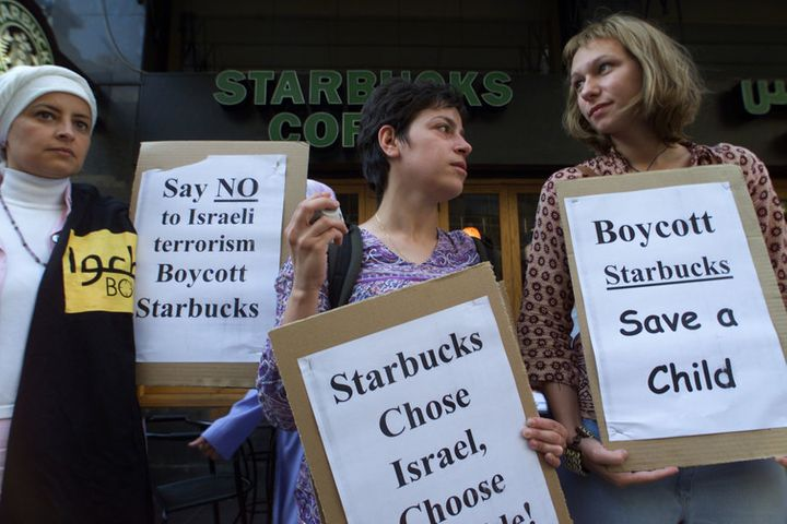 Lebanese women protests against Starbucks in 2002, accusing the US company of supporting Israel.