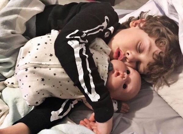 """""""Benny slept with his baby every night for months. Both my boys have dolls and love to play with them. Some days they throw t"""