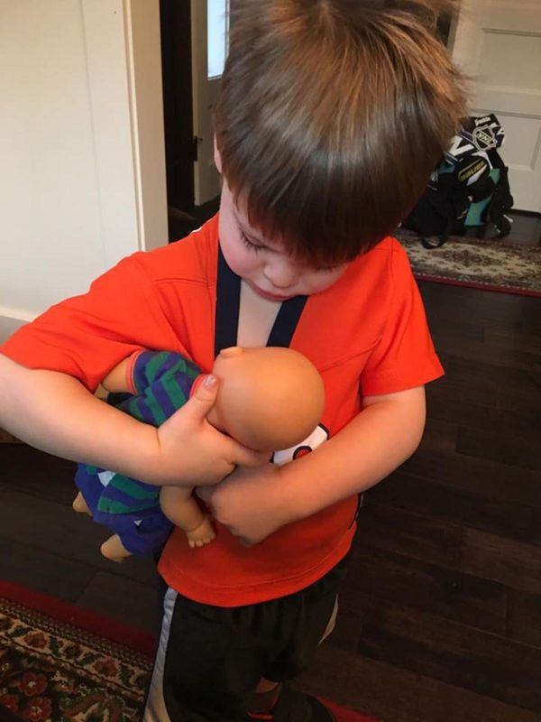 """""""My 3-year-old son helping to normalize breastfeeding."""""""