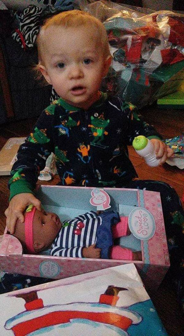 """This is Caleb (16mo in picture). He saw this doll, and wanted it very, very much. Santa was kind enough to bring it. He like"