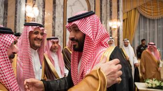 Saudi Arabia's Crown Prince Mohammed bin Salman (R) speaks with members of the royal family during an allegiance pledging ceremony in Mecca, Saudi Arabia June 21, 2017. Bandar Algaloud/Courtesy of Saudi Royal Court/Handout via REUTERS. ATTENTION EDITORS - THIS PICTURE WAS PROVIDED BY A THIRD PARTY.