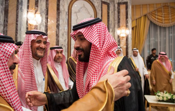 Saudi Arabia's Crown Prince Mohammed bin Salman (R) speaks with members of the royal family during an allegiance pledging cer