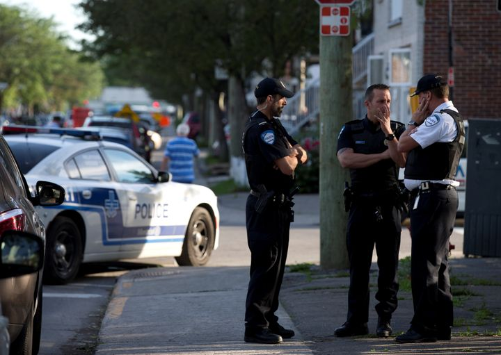 Police investigators talk outside the Montreal home of Amor Ftouhi, June 21, 2017. Ftouhi has been identified as a suspect in