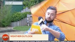 This Man Getting Owned By A Giant Umbrella Is Truly