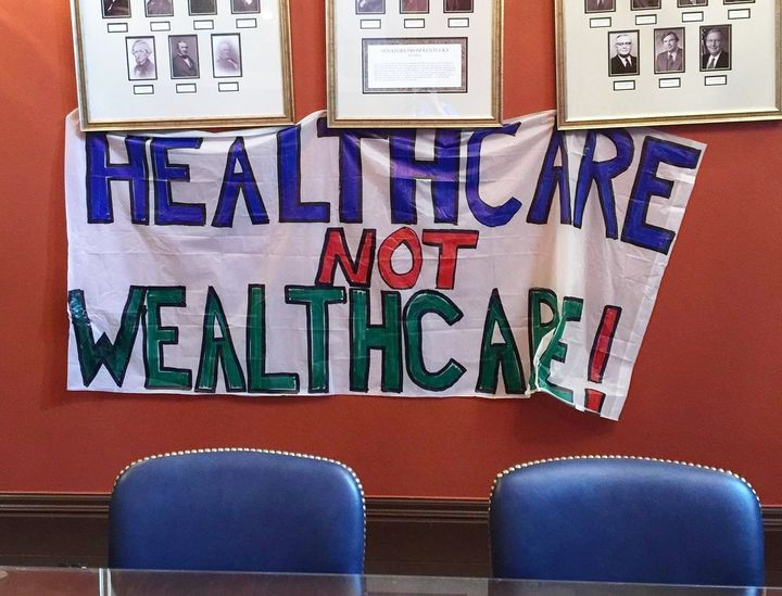 Protester Stephanie Woodward took this photo of a banner protesters hung in the office of Senate Majority Leader Mitch McConn