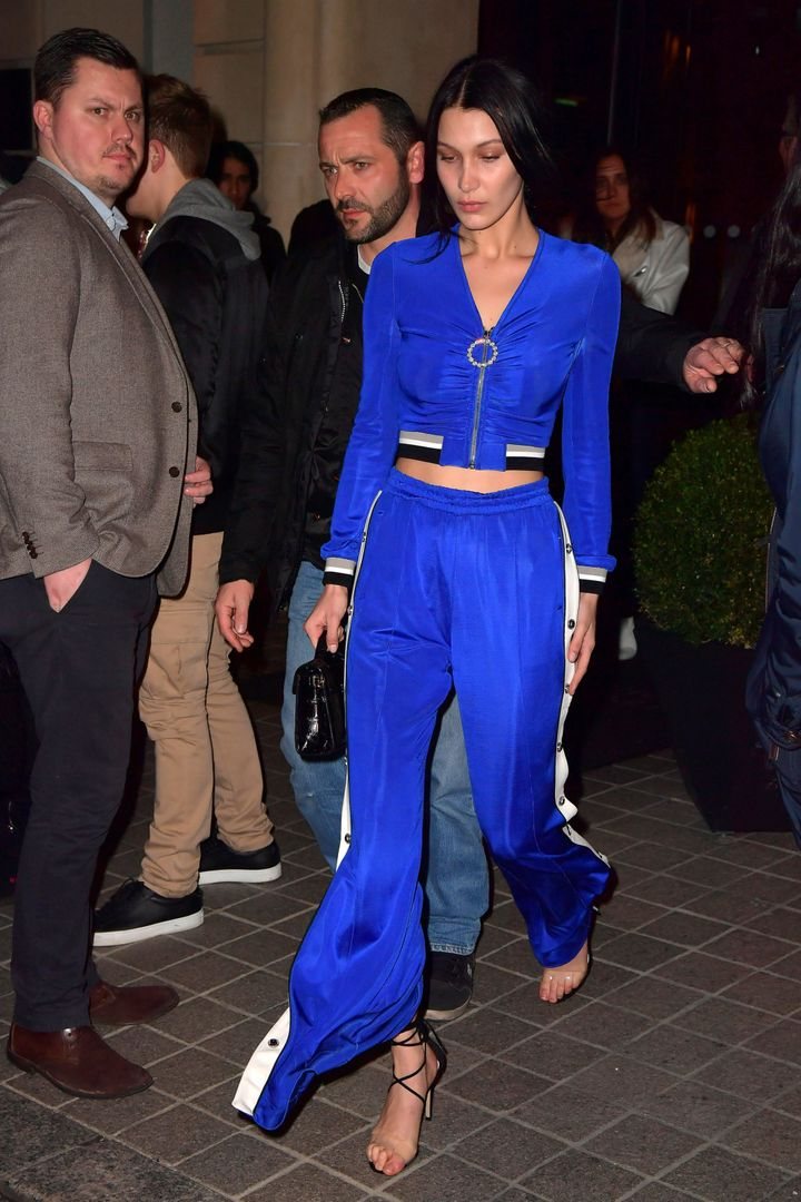 Bella Hadid paired strappy stilettos with a tracksuit at Paris Fashion Week in March. While her coordinates were not quite PJs, the same principles apply.