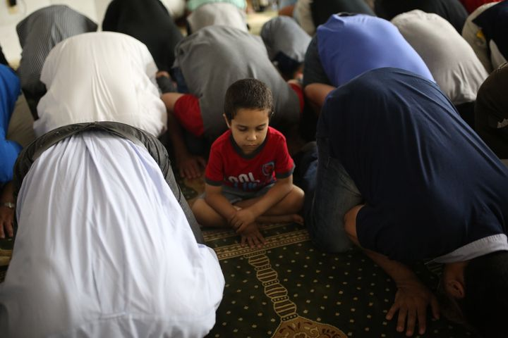 A child sits during a prayer on Laylat al-Qadr on the 27th day of the fasting month of Ramadan in New Jersey, United States o