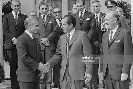 President Richard Nixon, with top advisors, welcomes the Shah of Iran, Mohammed Reza Pahlavi, to the White House. That is Nat