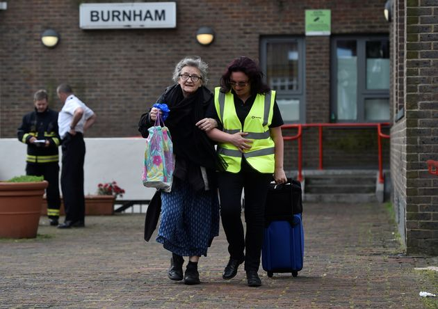 A resident is evacuated from the Burnham Tower residential block following concerns over the type of...