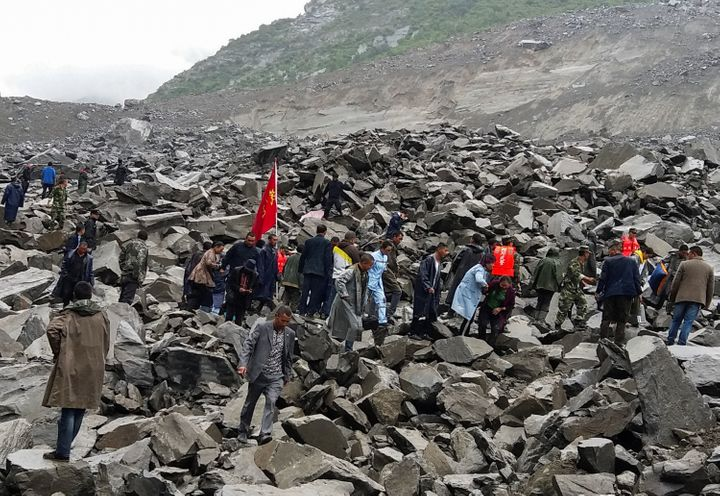 Second landslide stalls rescue efforts in China as almost 100 remain missing