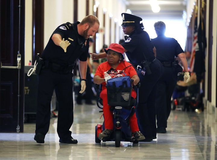 U.S. Capitol Police remove protesters from in front of the office of Senate Majority Leader Mitch McConnell on June 22, 2017.
