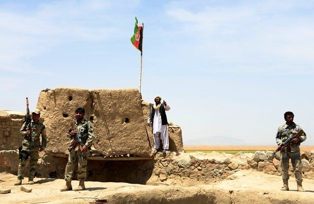 Afghan Border Police personnel keep watch during an ongoing battle between Pakistani and Afghan border forces near the Durand