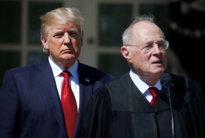 President Donald Trump listens as Justice Anthony Kennedy speaks during the swearing in ceremony for Judge Neil Gorsuch.