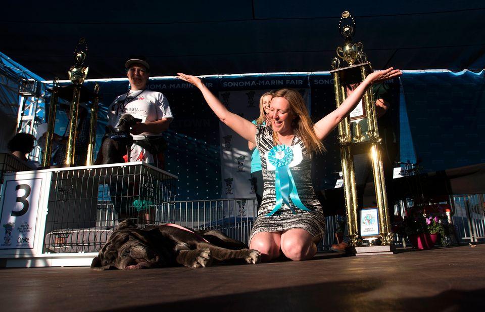 Martha'shandler Shirley Zindler celebrates, while Martha snoozes. Martha wona cash prize...