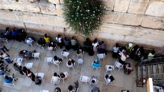 Jewish women pray at the women's section of the Western Wall in the old city of Jerusalem on May 16, 2017. / AFP PHOTO / THOMAS COEX        (Photo credit should read THOMAS COEX/AFP/Getty Images)