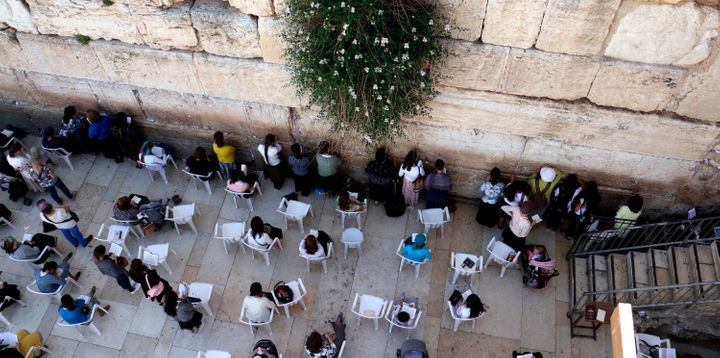 Jewish women pray at the women's section of the Western Wall.
