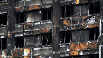 Damage to Grenfell Tower is seen following the catastrophic fire, in north Kensington, London, Britain, June 25, 2017.  REUTERS/Peter Nicholls