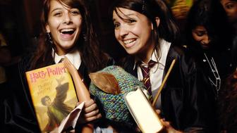 UNITED STATES - JULY 21:  Fans pick up first copies of books by Scholastic CEO Dick Robinson at the midnight release of JK Rowling's 'Harry Potter and the Deathly Hallows'' at The Scholastic Store in Manhattan.  (Photo by James Keivom/NY Daily News Archive via Getty Images)
