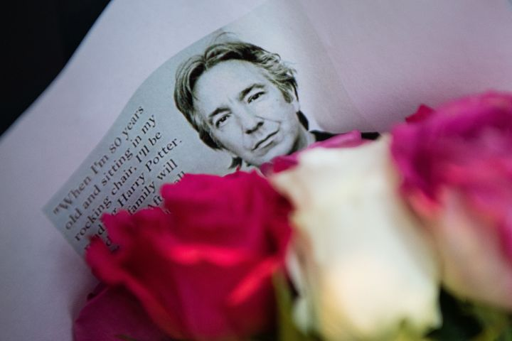 Floral tributes to British actor Alan Rickman are seen at the Platform 9 3/4 Harry Potter display at King's Cross station in