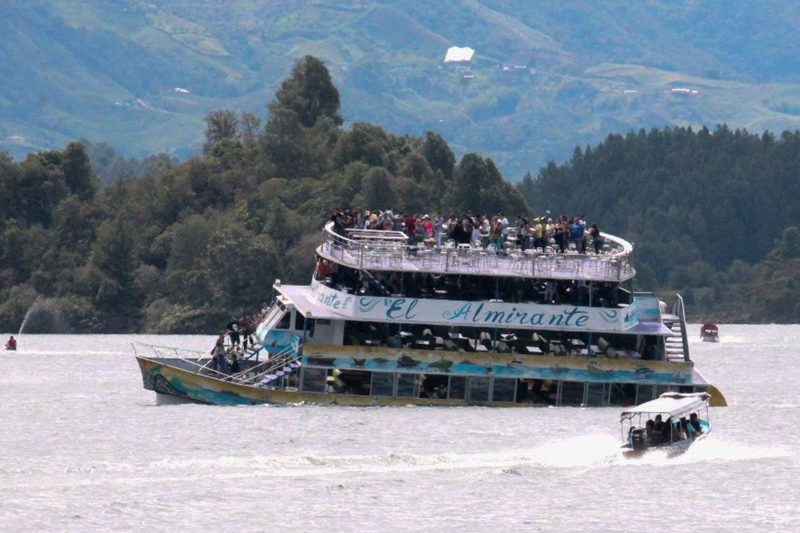 The tourist boat Almirante is seen in the Reservoir of Penol in Guatape municipality in Antioquia  on June 25, 2017. At least nine people were dead and 28 missing after a tourist boat sank for unknown reasons in a reservoir in Colombia Sunday, authorities said, sharply raising an earlier toll. / AFP PHOTO / Juan QUIROZ        (Photo credit should read JUAN QUIROZ/AFP/Getty Images)