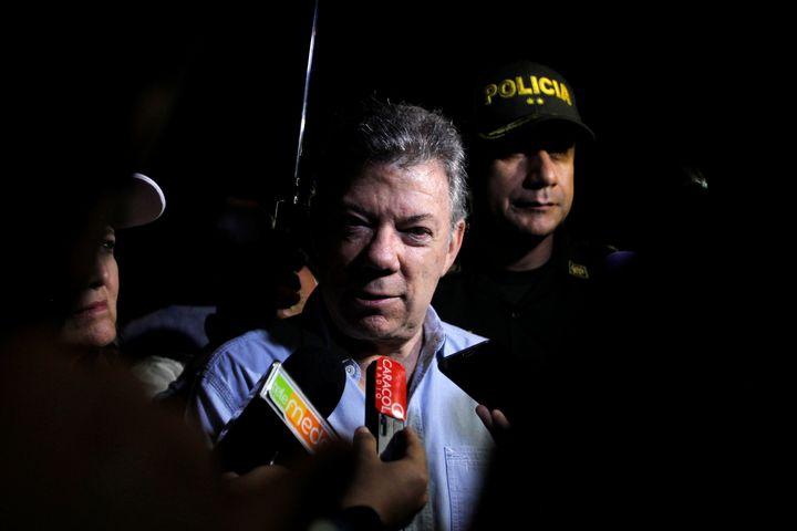 Colombian President Juan Manuel Santos at the scene near the Guatape reservoir.