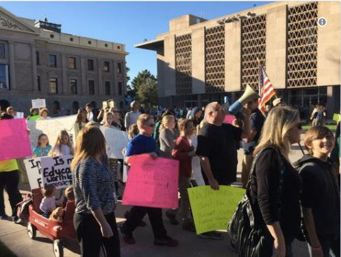 Protesting education budget cuts at Arizona state capital.