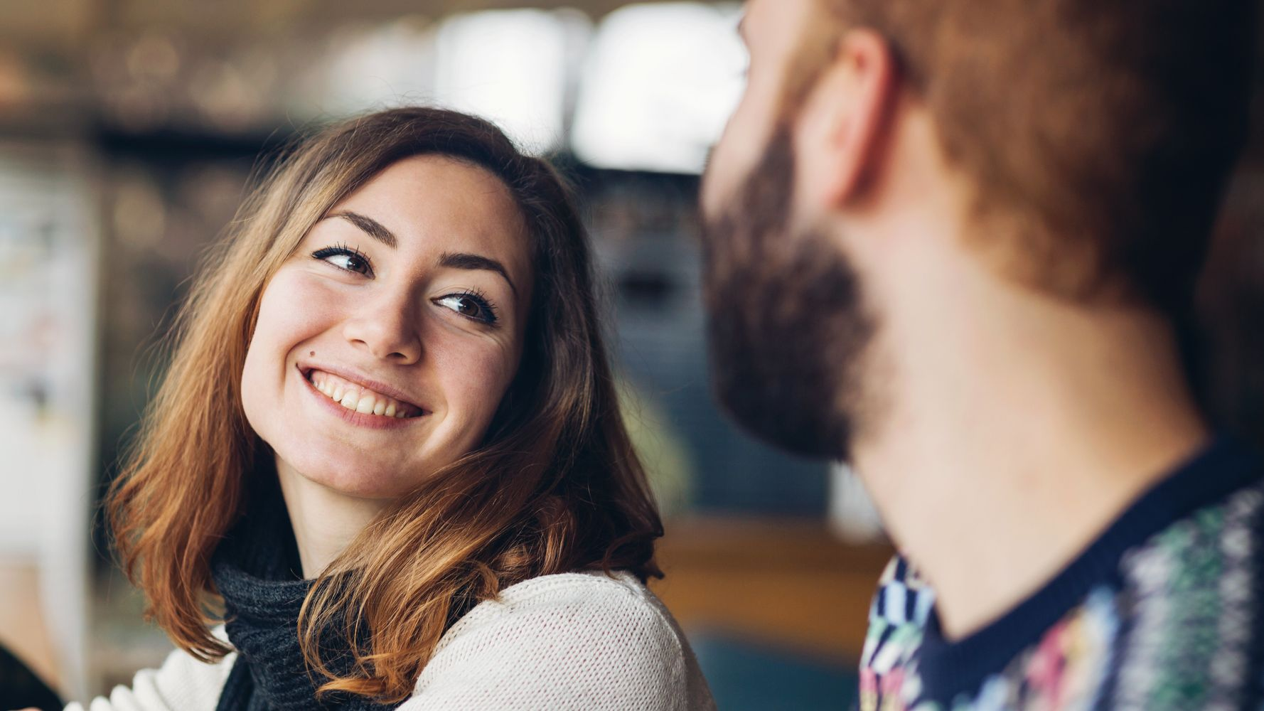 How To Tell Someone Is Flirting With You (And Not Just Being