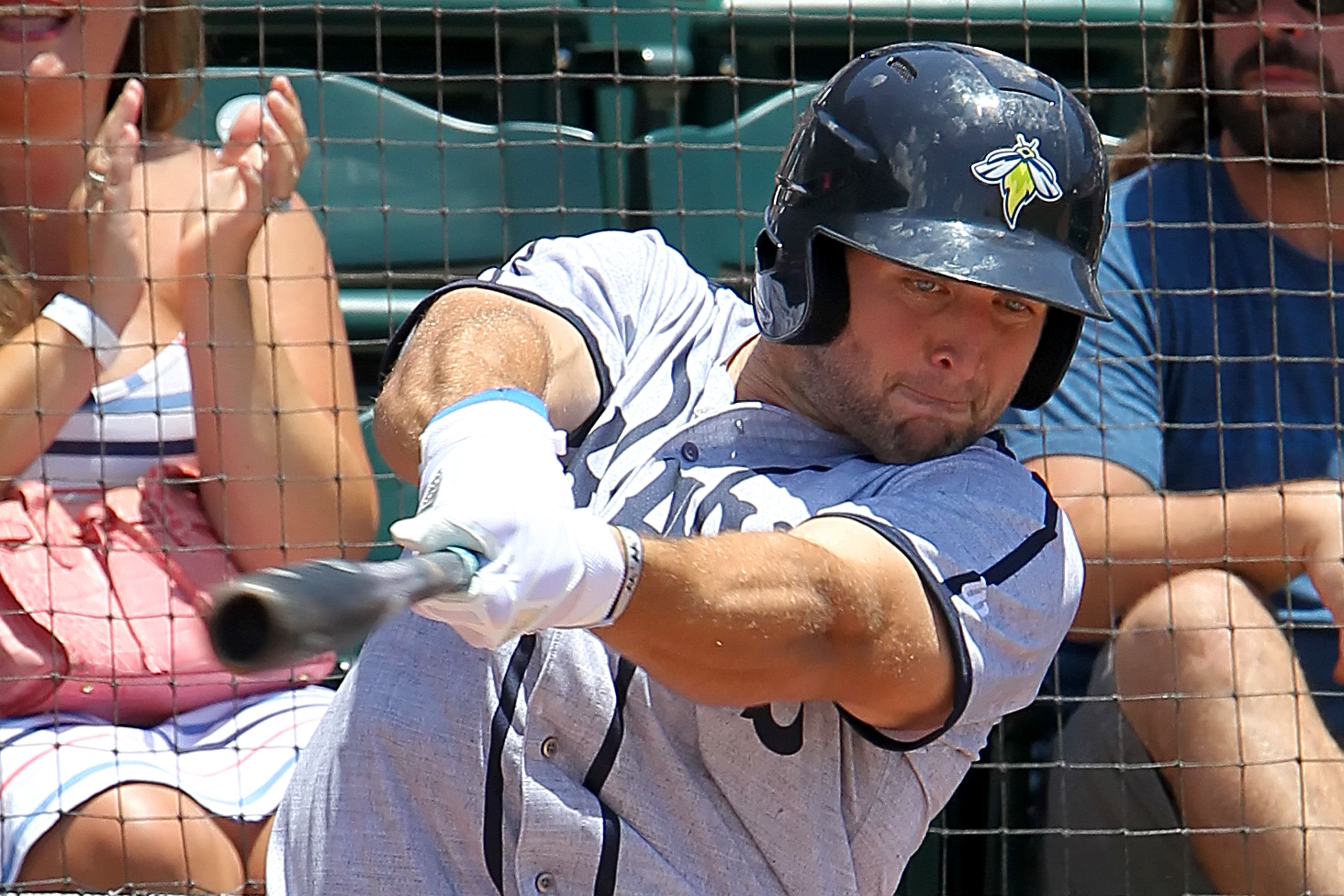 CHARLESTON,SC - JUNE 18: Tim Tebow of the Fireflies warms up on the on deck circle during the minor league game between the Columbia Fireflies and the Charleston RiverDogs on June 18, 2017 at AT&T Stadium in Charleston, South Carolina. (Photo by Cliff Welch/Icon Sportswire via Getty Images)