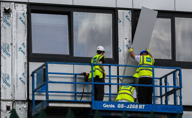 PA Wire  PA Images Potentially dangerous cladding is removed from an estate in Manchester